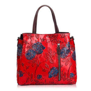 Front view of embossed red handbag